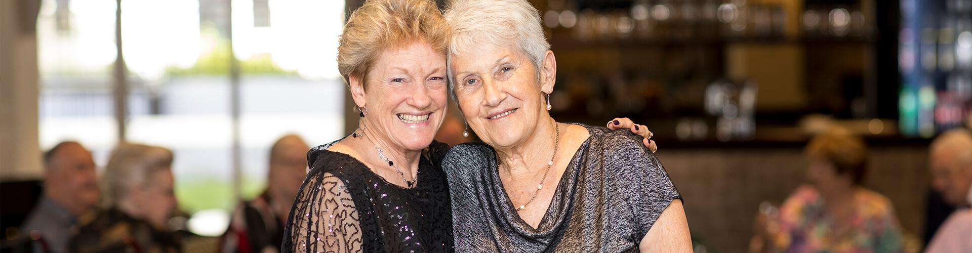 Nellie Melba Two ladies hugging