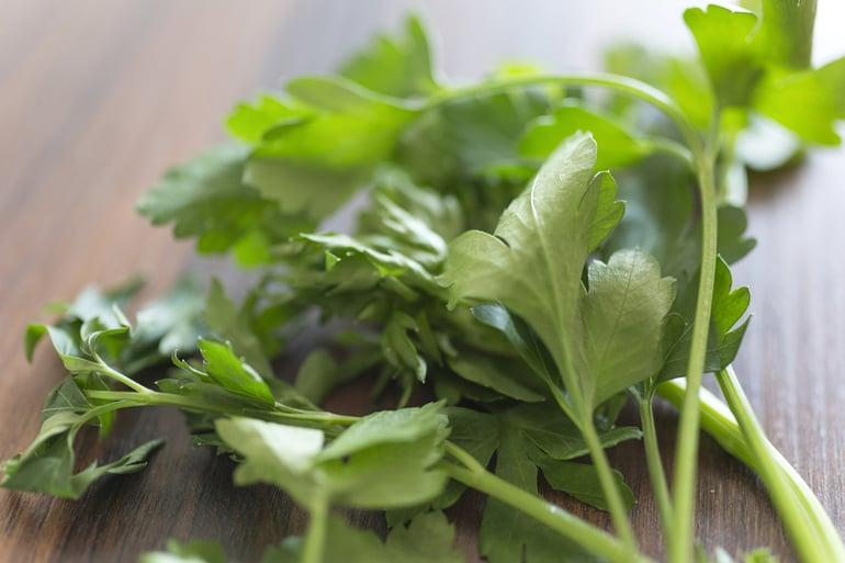Fresh parsley on a wooden chopping board