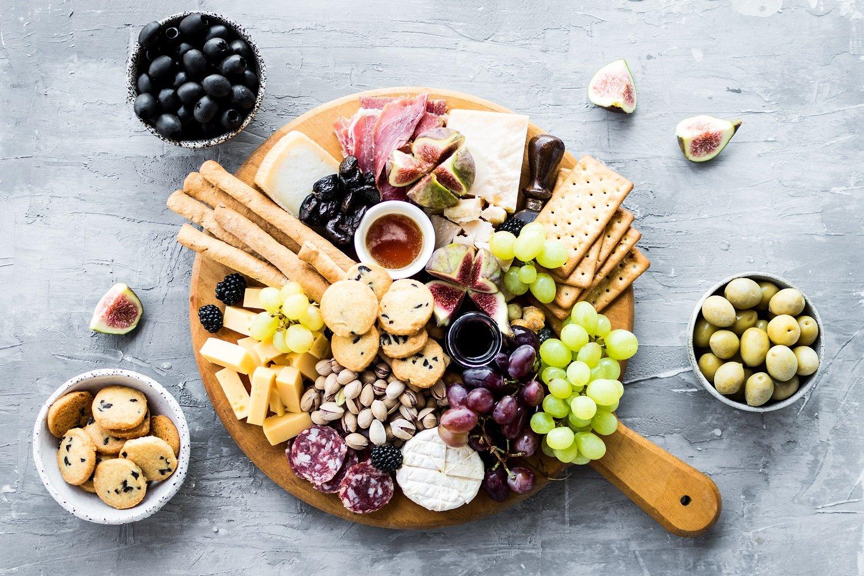 bigstock-Charcuterie-Board-Cheese-Plat-386152660